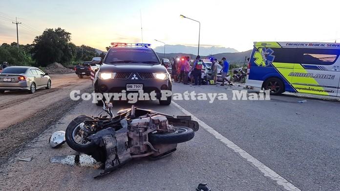 Kumron Inpan's motorbike is totalled after being hit bya passenger car on Highway 332 in Sattahip.