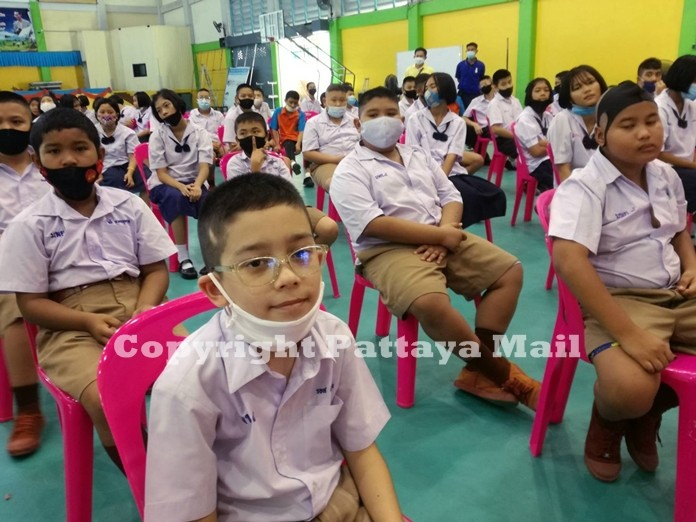 A student looks thoroughly please with his new eye glasses.