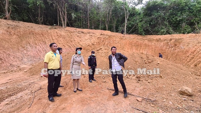Forestry department officials inspect the area of encroachment.