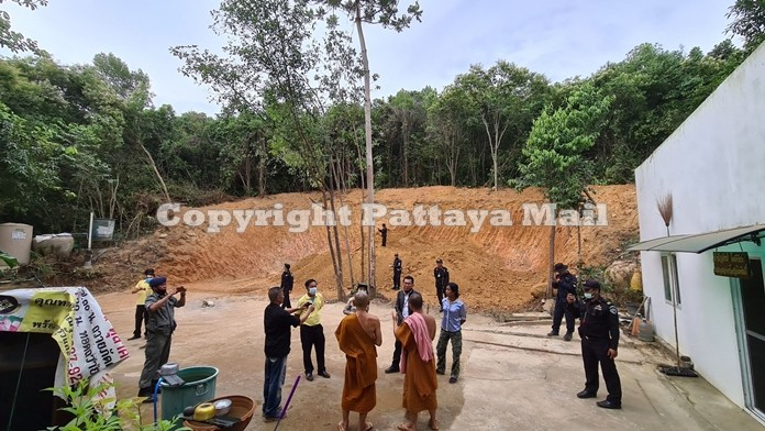 Monks talk to Banglamung district officials about the excavation work around their abbey.
