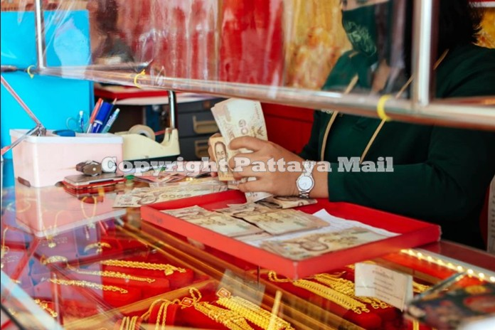 Gold merchants paid out millions of baht buying up as much gold as the people wanted to sell.