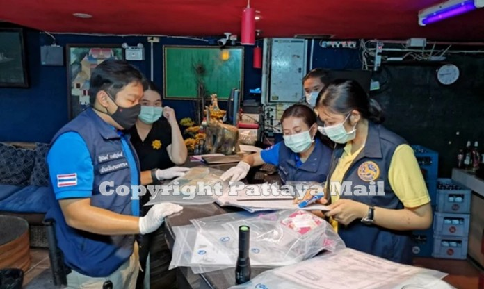 Officials from Special Operation Team inspect documents of the establishment accused human trafficking, pimping of underage minors.