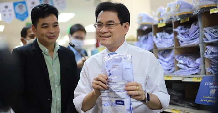 Minister of Commerce Jurin Laksanawisit leads the Lot 5 'Back To School' sale activity at Suksapan Panit Lad Phrao store, Bangkok.