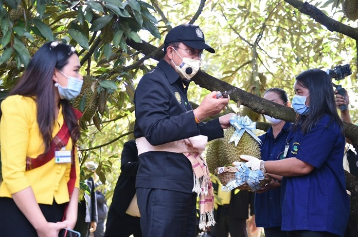 Prime Minister Gen Prayut Chan-ocha visits a durian plantation in Kantharalak district, Si Sa Ket.