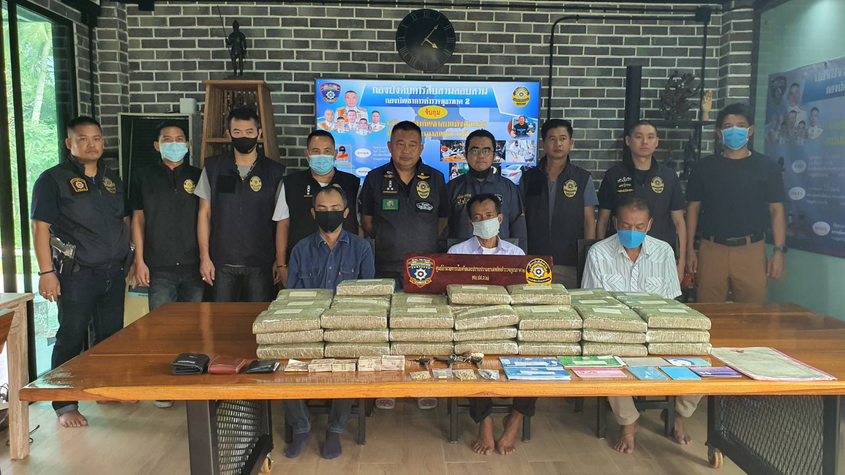 Pattaya police seized 66 kilograms of marijuana, crystal methamphetamine and piles of cash when they smashed a major drug network stretching from Pattaya to Saraburi.