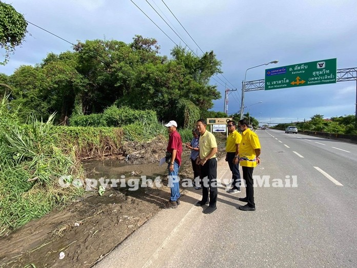 Pattaya Deputy Mayor Pattana Boonsawad inspects the area along the railway road just before the Khao Talo-Thepprasit junction where he found the natural waterways blocked by man-made construction such as the road and temporary dwelling.